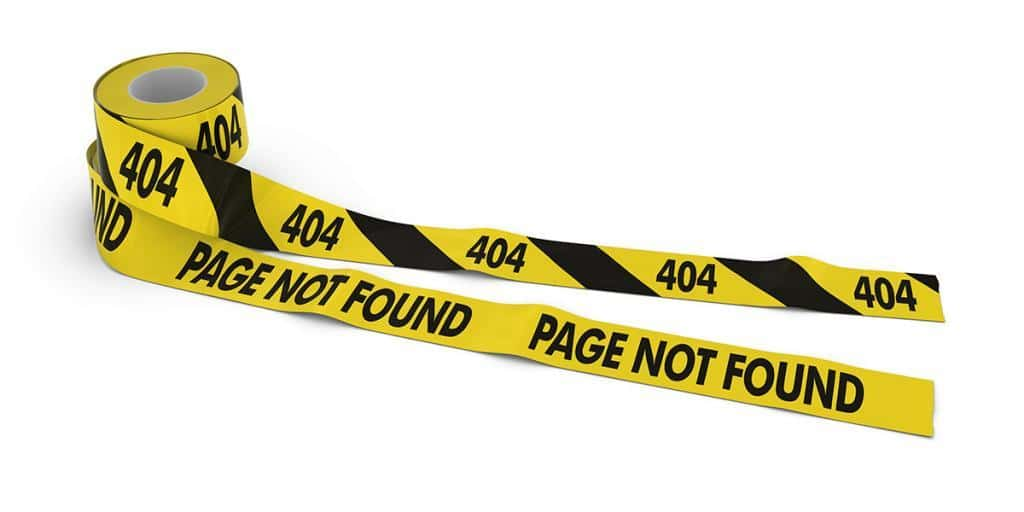 404 and PAGE NOT FOUND Tape Rolls unrolled across white